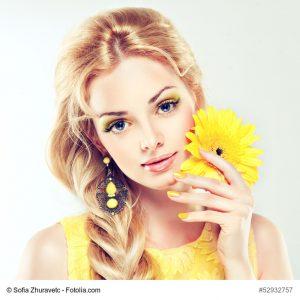 Beautiful model with yellow makeup.