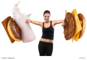 Fit young woman pushing fast food